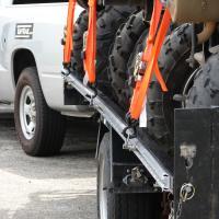 Detail of three ATV's lashed down.